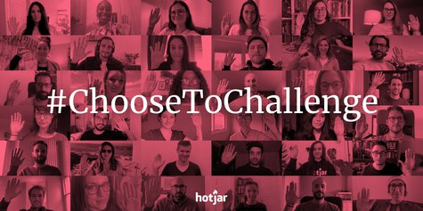 The Hotjar team doing the Choose To Challenge gesture, with the hashtag on top.
