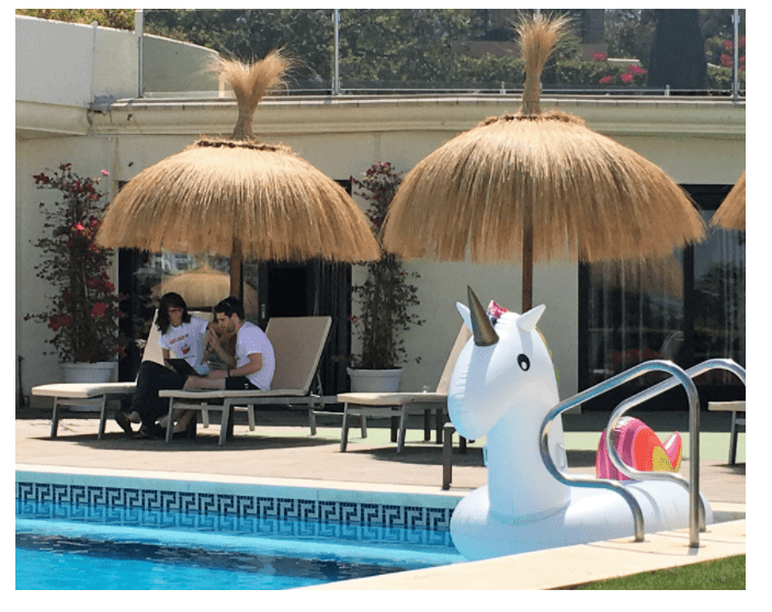 fio dossetto and louis grenier working pool side at Hotjar's company retreat